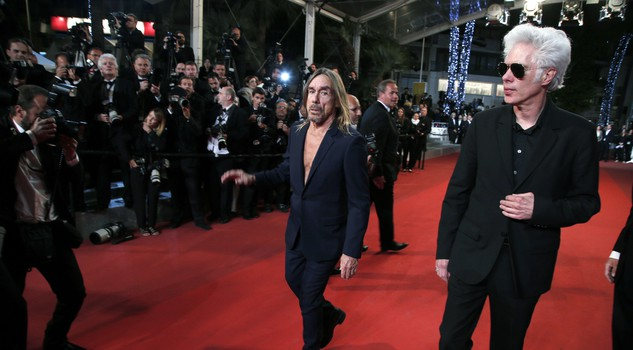 Singer Iggy Pop, centre and director Jim Jarmusch pose for photographers upon arrival at the screening of the film Gimme Danger at the 69th international film festival, Cannes, southern France, Friday, May 20, 2016. (ANSA/AP Photo/Thibault Camus)